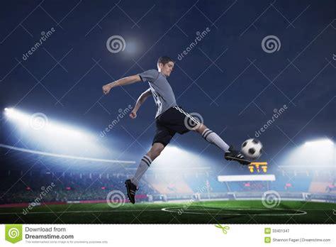 soccer player  mid air kicking  soccer ball stadium