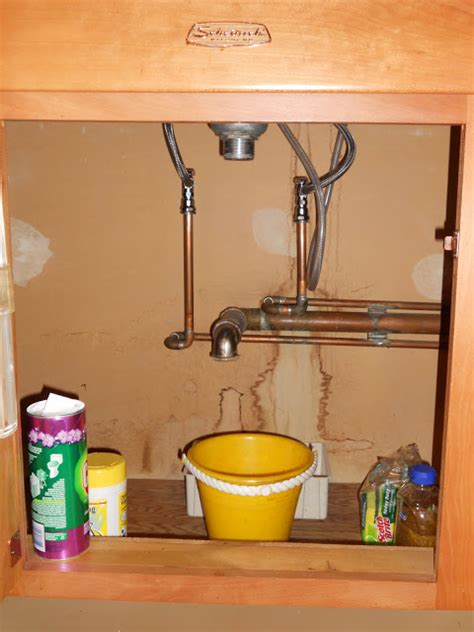 how to fix leaking pipe under sink how to fix leaky pipes under your kitchen sink me ed