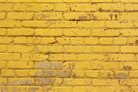 painted yellow brick wall background texture in bright