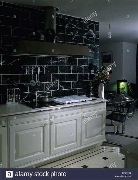 black kitchen wall tiles black wall tiles above white fitted units in modern white 4726