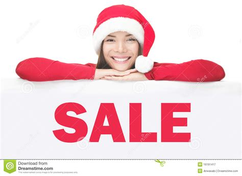 santa woman showing sale sign board royalty free stock