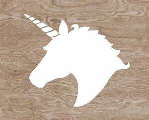 Blanche Silhouette de tête de licorne sur brun bois Grain Faux