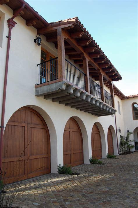 arched mediterranean architecture revival entrance garage doors patio  beach architec single