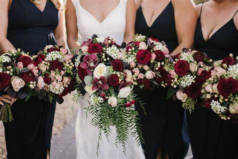 jaimi alexs modern black tie wedding  burgundy bouquets