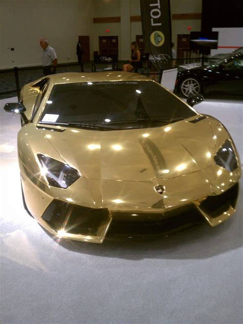 How Much Does A Maserati Cost by Golden Lamborghini Aventador At The Miami International