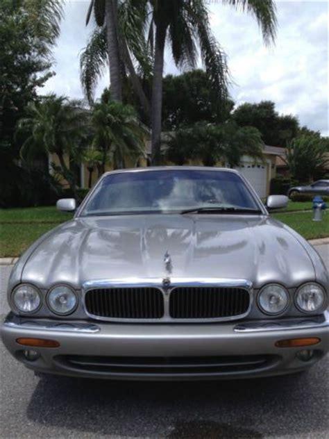 purchase  jaguar xj silver  sedan  door