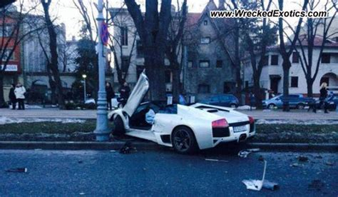 crashed white lamborghini lamborghini murcielago lp640 roadster crashes in romania