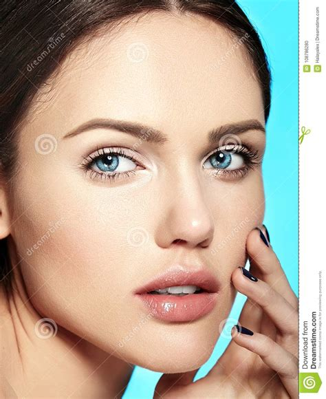 Model With Nude Makeup Touching Her Perfect Clean Skin