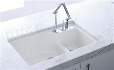 kohler     undercover double offset cast iron kitchen sink   indio series white