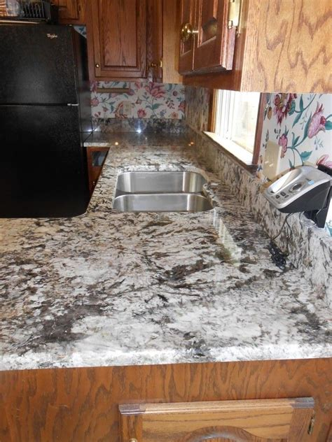 bianco antico granite for a traditional kitchen with a
