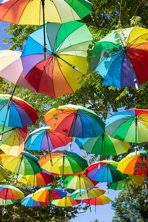 Colorful umbrellas hanging as street decorations by ...
