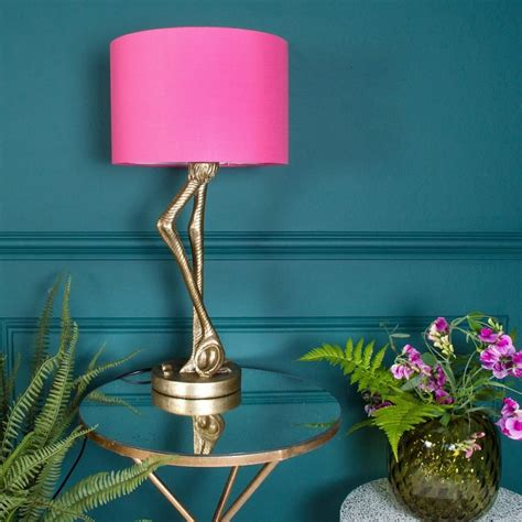 brass flamingo leg table lamp  pink shade id lights