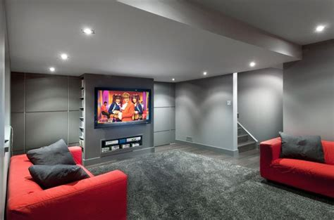Modern Basement With Grey Walls And Red Sofa