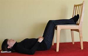 lie down with legs resting over a chair to ease back pain With back pain when lying down