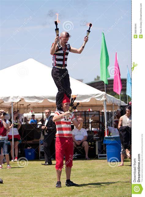 circus performers prepare to juggle flaming batons
