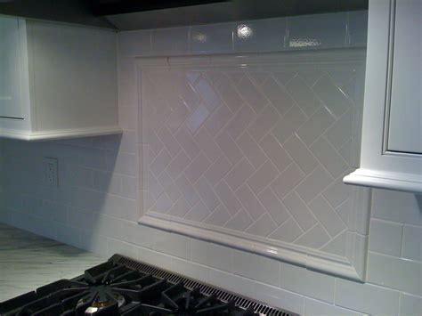 white subway tile with herringbone backsplash stove