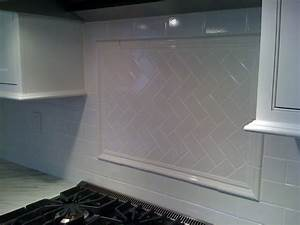 White subway tile with herringbone backsplash behind stove for Subway tile backsplash behind stove