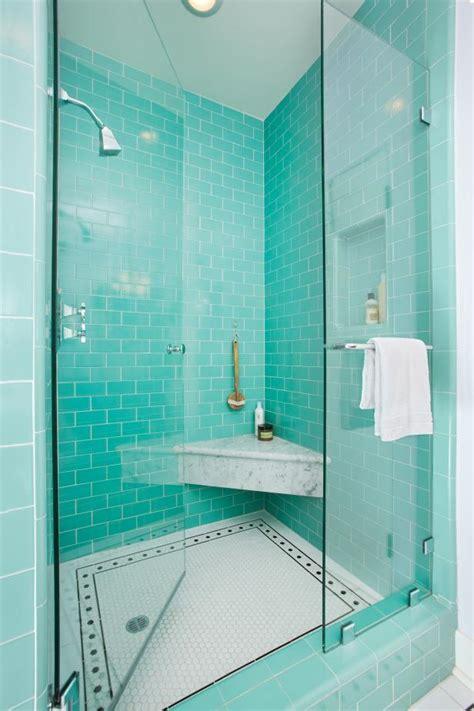 teal subway tile shower adds pop  color  tudor homes