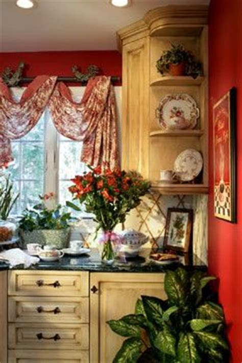 french country kitchen with cream cabinets black hardware