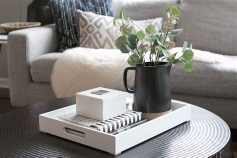 Trays are usually inexpensive and having a few different types of trays will give you lots of variety when you style a coffee table! Tips to Style a Round Coffee Table | Round coffee table, Decorating coffee tables, Round black ...