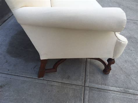 Pair Of English High Back Antique Walnut Sofas In Linen