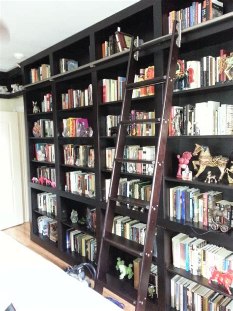 built  bookcases  rolling ladder  hidden vault