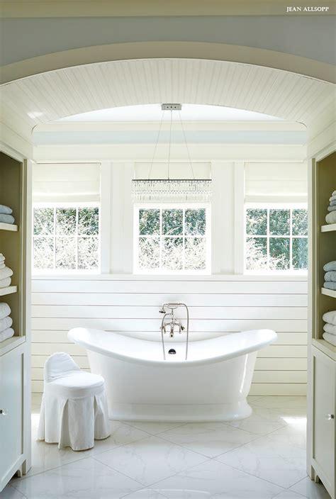 linear crystal chandelier over vintage tub cottage