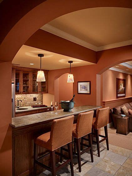 monochromaticclay color  walls stools wood finishes gray  tile floor lighter ceiling
