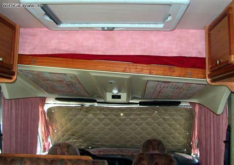 verin lit camping car table de lit