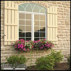 Arched shutters exterior window shutters by hooks lattice for Arched shutters exterior