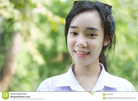 Thai Student Teen Beautiful Girl Relax And Smile In Park