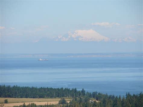 Views Of Mountains And The Sea Make This South Home Truly Stunning by Mountain View Sequim Daily Photo