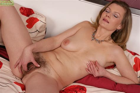 busty older woman with hairy pussy ridding panties for masturbation session