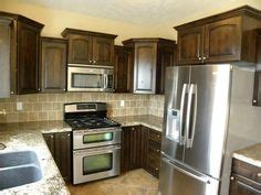 types of cabinets for kitchen the grand island is the focal point of this bright and 8623