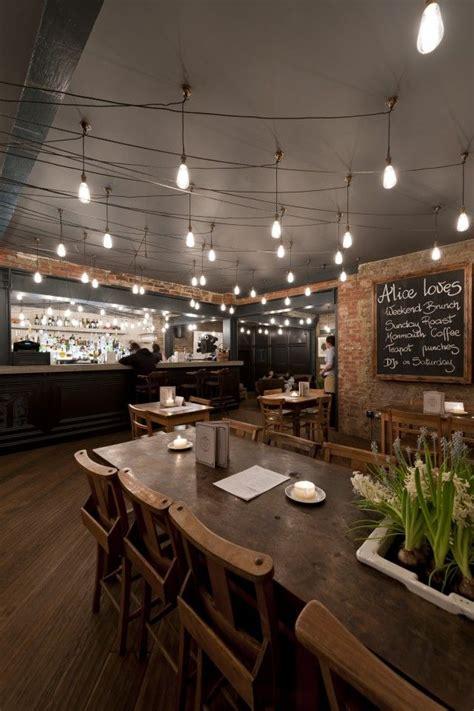 rustic  kitchen  dark walls   dark wood floor give   classy feel hardwood