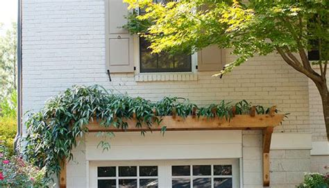 garage remodel ideas   budget planters wood garage doors  empty spaces