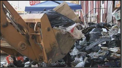 backhoe   clear trash  house abccom