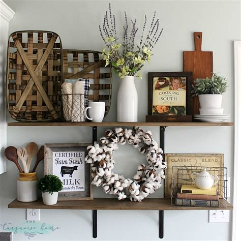 decorating a farmhouse decorating shelves in a farmhouse kitchen