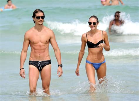 paul simon swimsuit candice swanepoel and hermann nicoli photos photos