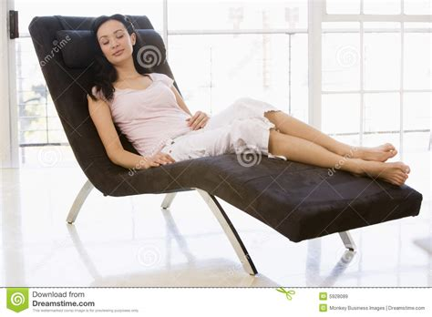sitting in chair sleeping royalty free stock images