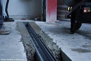 rain water flooding garage door garage door repair san With garage floor slope to drain