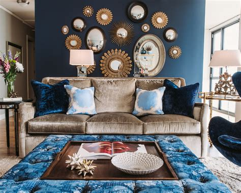 light brown sofa and blue egg chair with mirrored furniture dining room chandelier in blue
