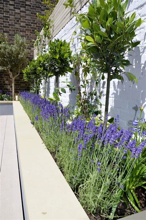 In a garden setting a deck is often surrounded by plants and flowers to help you blend in with nature. Raised beds painted grey composite limed decking bench ...