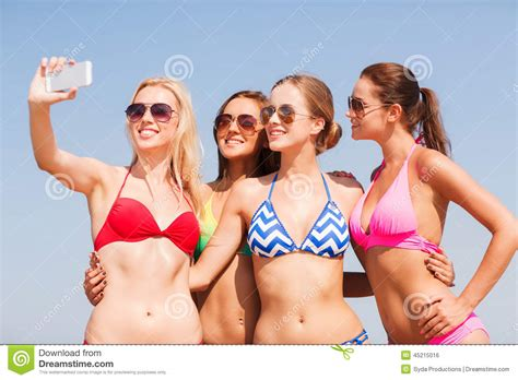 Group Of Smiling Women Making Selfie On Beach Stock Photo
