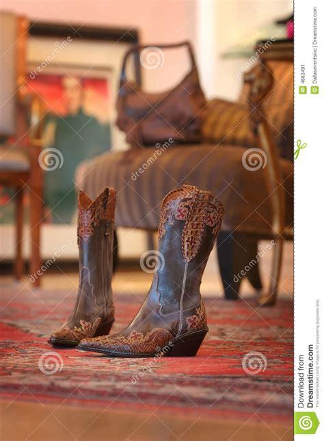 ladies cowboy boots sitting   red carpet stock image