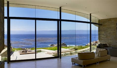 floor to ceiling glass windows taking advantage of the outdoors with floor to ceiling windows