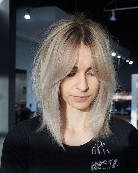 Shaggy Curtain Banged Lob with Undone Straight Texture and