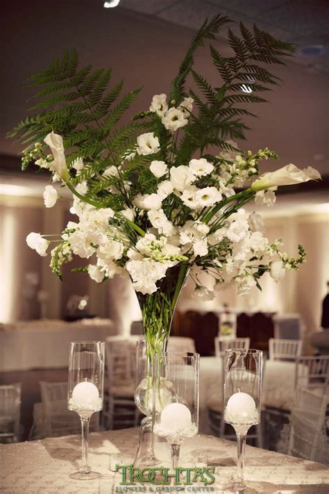 Tall White Floral Centerpieces With Large Fern Leaves For. Bride And Groom Wedding Invitation Wording Informal. Wedding Used Linen. Elephant Wedding Favor Boxes. Wedding Thank You One Year Later. Wedding Centerpiece Flowers Online. Wedding Favors Wine. Wedding Hair Styles Medium Hair. Wedding Venues Poconos