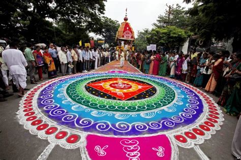 A Mandala Drawn With Colored Powder Is Surrounded By Hindu