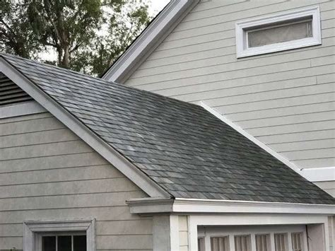 tesla s solar roof tiles will be available to pre order